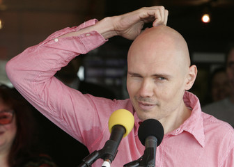 "Billy Corgan, member of the rock group ""Smashing Pumpkins"", speaks to the audience just before he and band member Jimmy Chamberlin are inducted into the Hollywood Rock Walk in Hollywood"