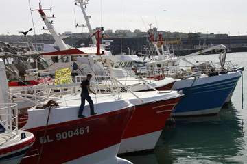 A striking fisherman is seen on his trawler which blocks the fishing port in Boulogne sur mer