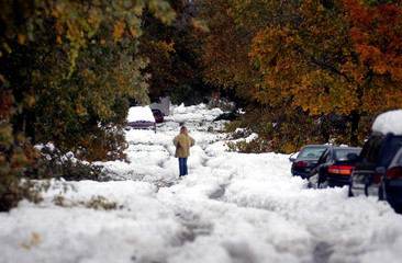 Chris Adamski stands in the middle of South Ellington Street after an unprecedented storm, in Depew