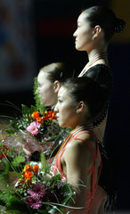 ARAKAWA, COHEN AND KWAN LISTEN TO NATIONAL ANTHEM DURING MEDAL CEREMONY OF THE WOMEN'S FREE SKATING ...