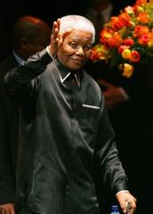 Former South Africa President Mandela waves to well-wishers as he celebrates his birthday in ...