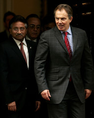 Britain's Prime Minister Blair and Pakistan's President Musharraf stand on steps Downing Street.