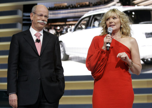 Zetsche, Chairman of the Board of Management of Daimler AG and head of Mercedes Benz cars listens to actress Cattrall after introducing the Vision SLK compact SUV concepts in Detroit