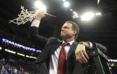 University of Kansas Jayhawks head coach Self celebrates after cutting down his piece of net in Kansas City