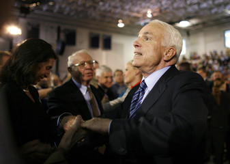 Republican presidential nominee Senator John McCain greets supporters during a rally at Cape Fear Community College in Wilmington, North Carolina