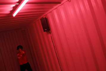 """Asencio, of Societat Doctor Alonso-Tomas Aragay company, performs inside a container during Madrid's """"Night of Theatres\"""