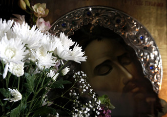 Flowers are placed next an icon inside an Orthodox monastery near Athens