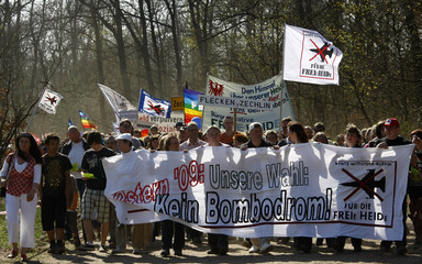 People hold a banner during a demonstration in the village of Fretzdorf