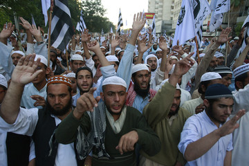 Supporters of Pakistani Islamist party JUI chant slogans against the Israeli air strikes on Gaza during a protest rally in Karachi