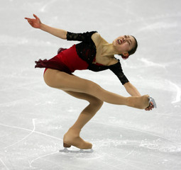 Fumie Suguri performs in the women's short program during the Figure Skating competition at the Winter Olympic Games
