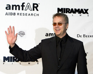U.S. actor Tim Robbins waves during red-carpet arrivals as part of the amFAR Cinema against AIDS 200..