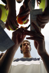 Murray of Britain signs autographs after his match against Roitman of Argentina at the U.S. Open tennis tournament in Flushing Meadows