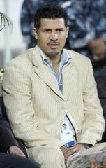 Saipa's coach Daei watches his team's Asian Champions League soccer match against Al-Kuwait Club in Kuwait City