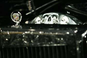 A 1984 Cadillac Fleetwood is displayed at Petersen Automotive museum in Los Angeles
