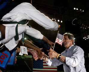 U.S. Democratic nominee Kerry reaches out to supporters at rally in Tampa.
