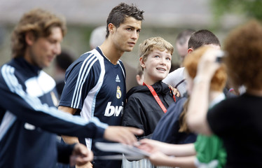 Real Madrid's Cristiano Ronaldo poses for pictures and signs autographs after a training session in Carton House Hotel in Maynooth