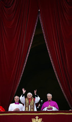Pope Benedict XVI, Cardinal Joseph Ratzinger of Germany, waves from a balcony of St. Peter's ...