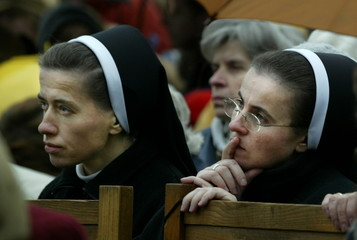 TWO YOUNG NUNS PRAY DURING HOLY MASS DEDICATED TO POPE JOHN PAUL II INWADOWICE.