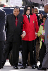 Pop star Michael Jackson arrives with his father Joe at the Santa Barbara County Courthouse in Santa Maria.