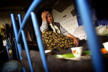 MUSLIM RETURNEE HOLDS HEAD IN BASEMENT OF DESTROYED HOUSE IN ORICI NEARSREBRENICA.