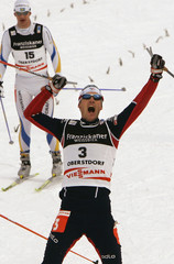 France's Vittoz celebrates his victory in the men's 30km pursuit cross country race at the Nordic ...