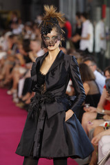 A model presents a creation by French designer Christian Lacroix as part of his Autumn/Winter 2008-2009 Haute Couture fashion collection in Paris