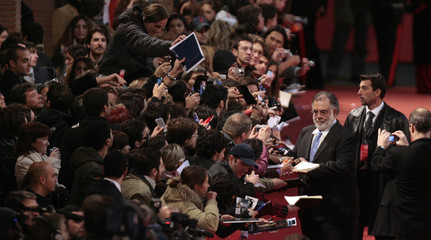 U.S. movie director Coppola signs autographs as he arrives for the world premiere of his latest movie in Rome