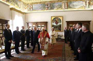 Belgium's King Albert II and Queen Paola walk with Pope Benedict XVI during a visit at the Vatican
