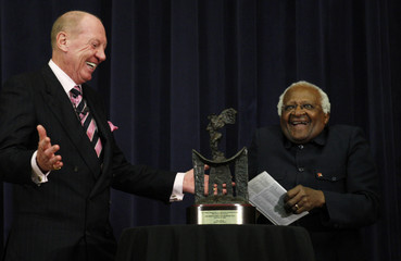 South African Archbishop Emeritus Desmond Tutu laughs as he is presented with the J. William Fulbright Prize for International Understanding Award in Washington