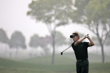 aphael Jacquelin of France tees off on the 8th hole during the China Open golf tournament in Shanghai