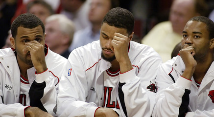 Bulls Allen Chandler and Harrington react to a loss in Chicago