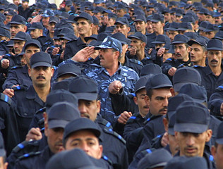 Iraqi police officers march during a graduation ceremony.