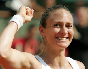 France's Mary Pierce, the number 21 seed, celebrates at the end of her game against [Russia's Elena ..