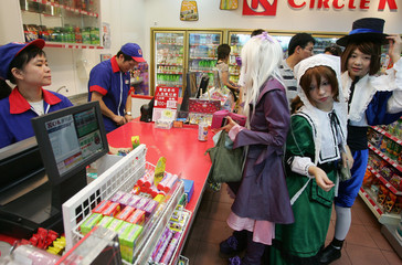 "Cosplay girls dressed up as characters from Japanese comic ""Rozen Maiden"" buy drink at a store during the Ani-com Hong Kong"