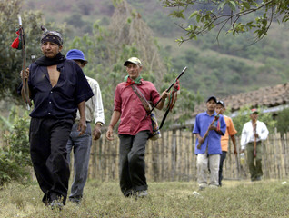 Colombian Indians walk near to the town of Toribio.