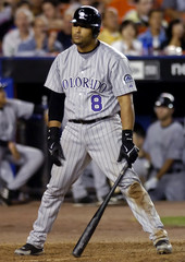 Colorado Rockies Yorvit Torrealba reacts to striking out against the Mets