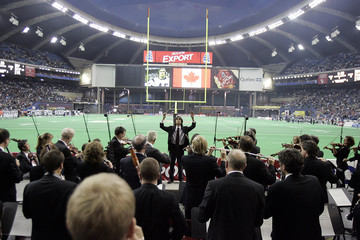 Musical director Kent Nagano leads Montreal Symphony Orchestra in national anthem prior to CFL game in Montreal