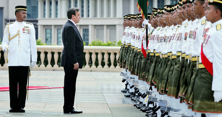 Prime Minister of Bosnia and Herzegovina Adnan Terzic bows to honour guard in Putrajaya