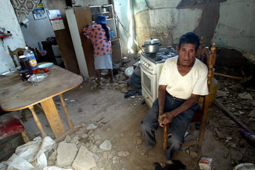 Aurelio Segundo sits in his house in Huara town after a earthquake in north of Chile.