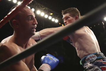 Hatton of Britain punches Malignaggi of the U.S. during a junior welterweight bout at the MGM Grand Garden Arena in Las Vegas