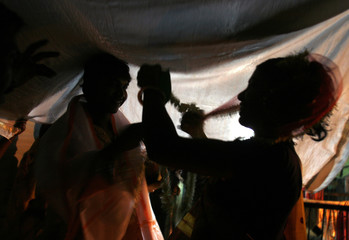 Indian sex worker Urmila performs ritual during her marriage ceremony with her client Krishna in Kolkata