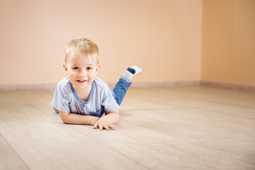 Portrait of a two years old child lying on the floor