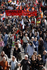 Demonstrators attend a protest march with public and private workers in Nantes