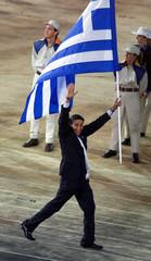 NIKOS KAKLAMANIKIS FROM GREECE ENTERS OLYMPIC STADIUM AT OPENING CEREMONY OF SYDNEY 2000 OLYMPIC GAMES.