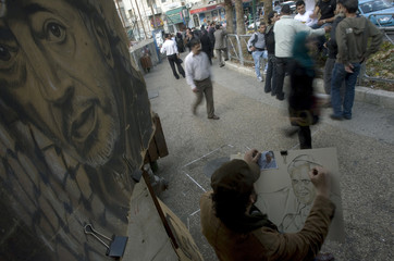 Palestinian artist draws a portrait depicting Pope Benedict in Ramallah