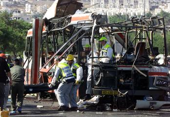 ISRAELI MEDICS REMOVE DEAD FROM BLOWN BUS IN JERUSALEM.