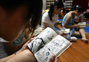 Chinese youth read Japanese comic books in Shanghai.