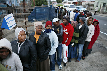 South Africans wait to vote outside a polling station to open in Cape Town's Khayelitsha township