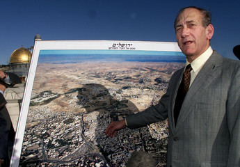 JERUSALEM MAYOR EHUD OLMERT EXPLAINS A MAP OF JERUSALEM NEAR THE TEMPLE MOUNT.