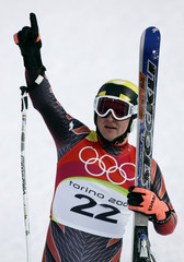 Hoffmann of Switzerland celebrates finishing third in the men's super-G at the Winter Olympic Games